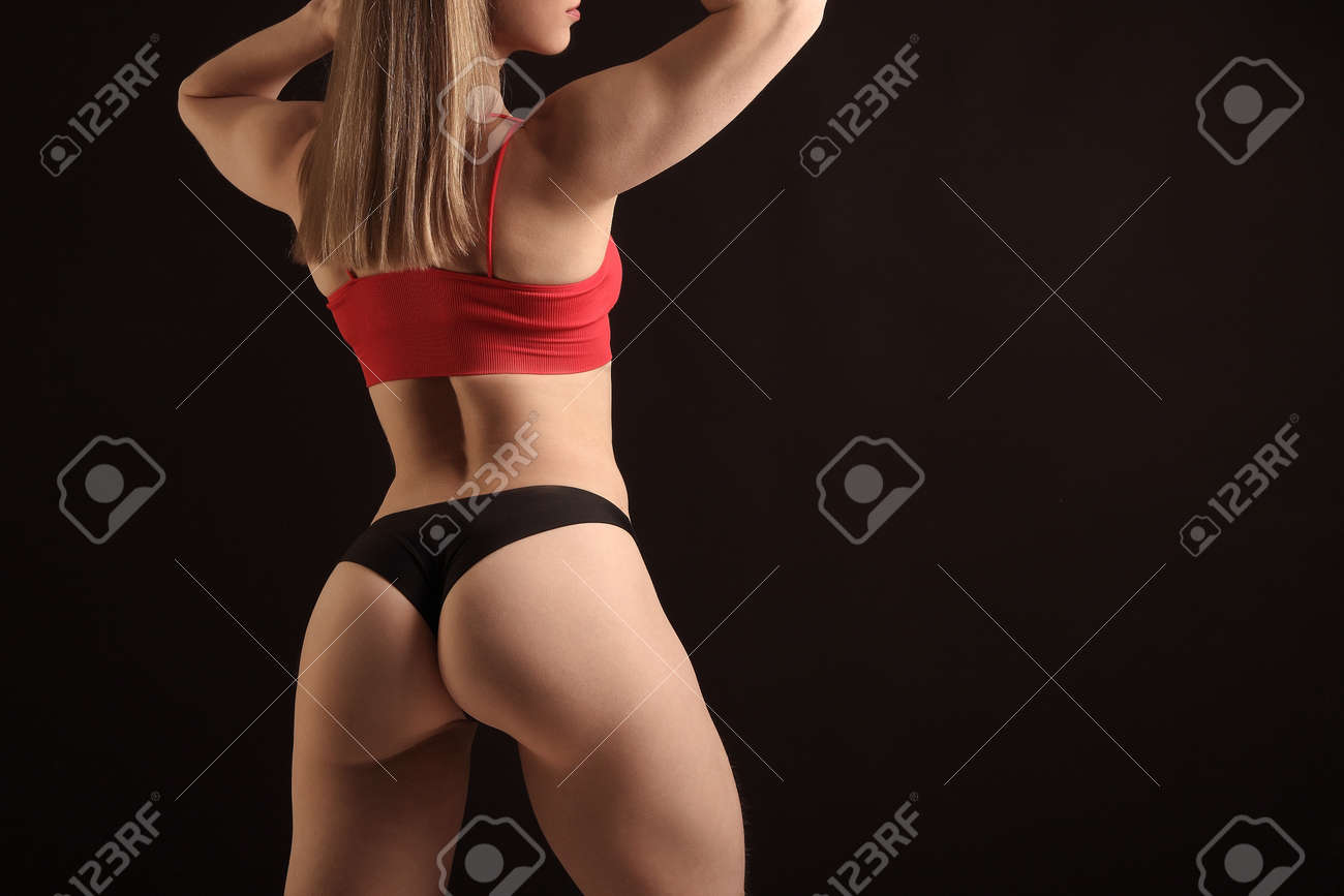 young fitness woman with beautiful athletic body - 169592165