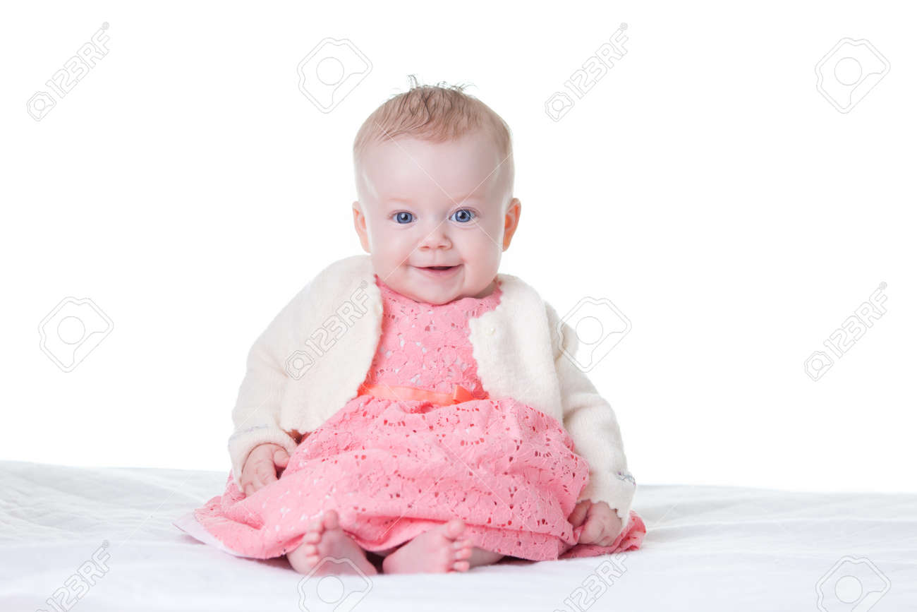 little cute baby-girl in pink dress, sitting, isolated stock photo