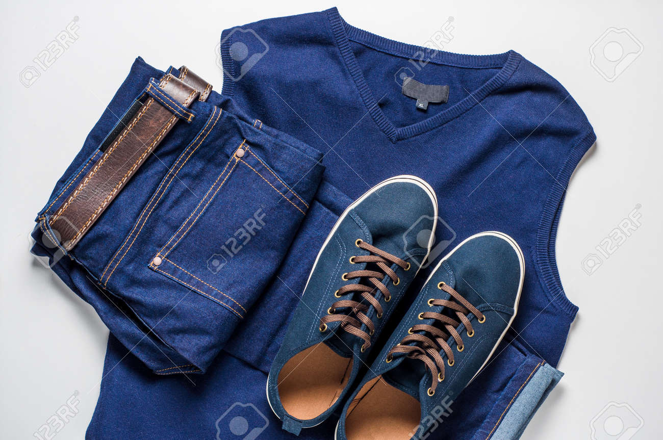 Fashionable men's clothing. Jeans and shoes on light background - 85720806