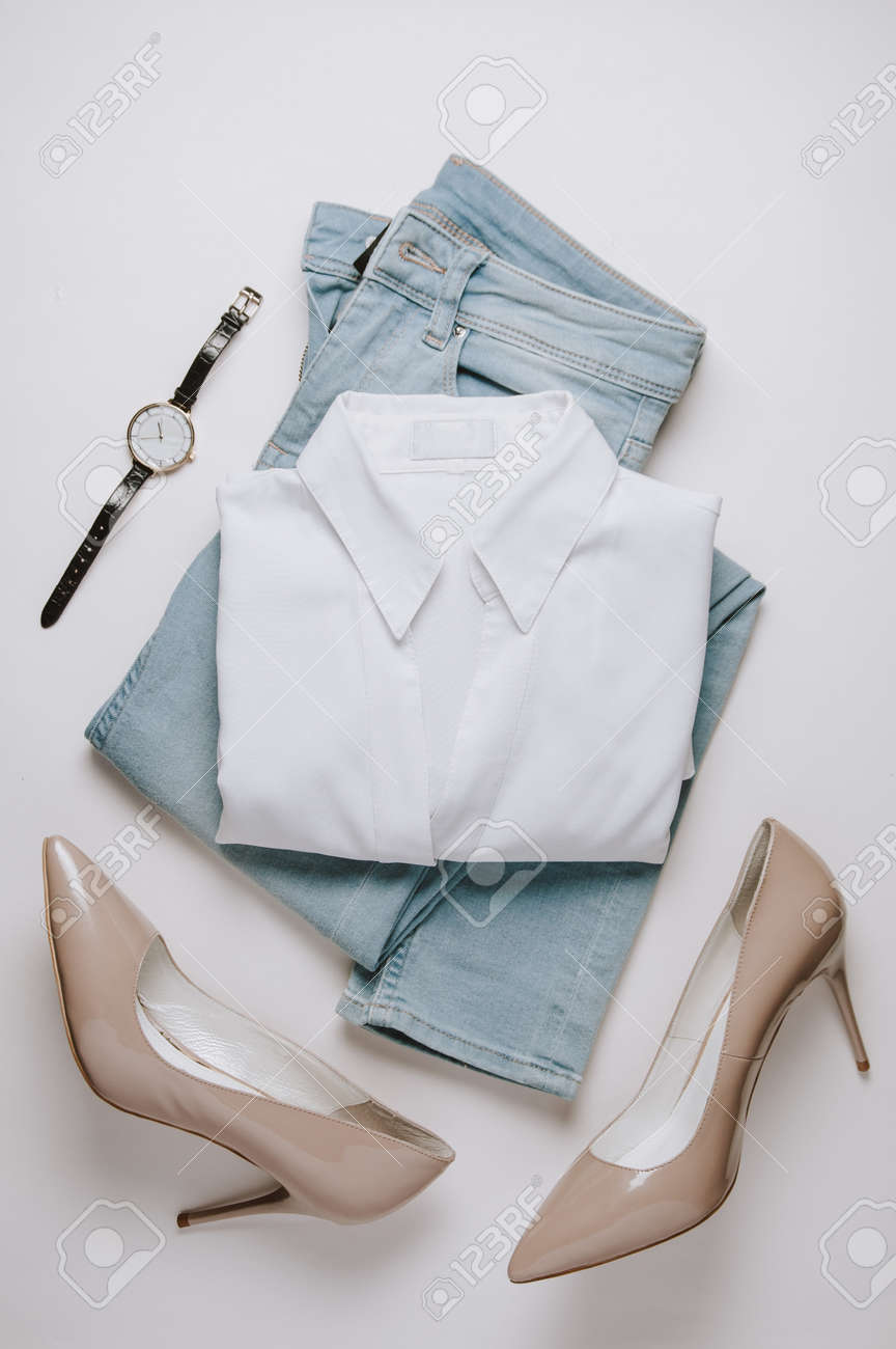 Women's clothing on a pale background. Flat lay and top view - 121677135