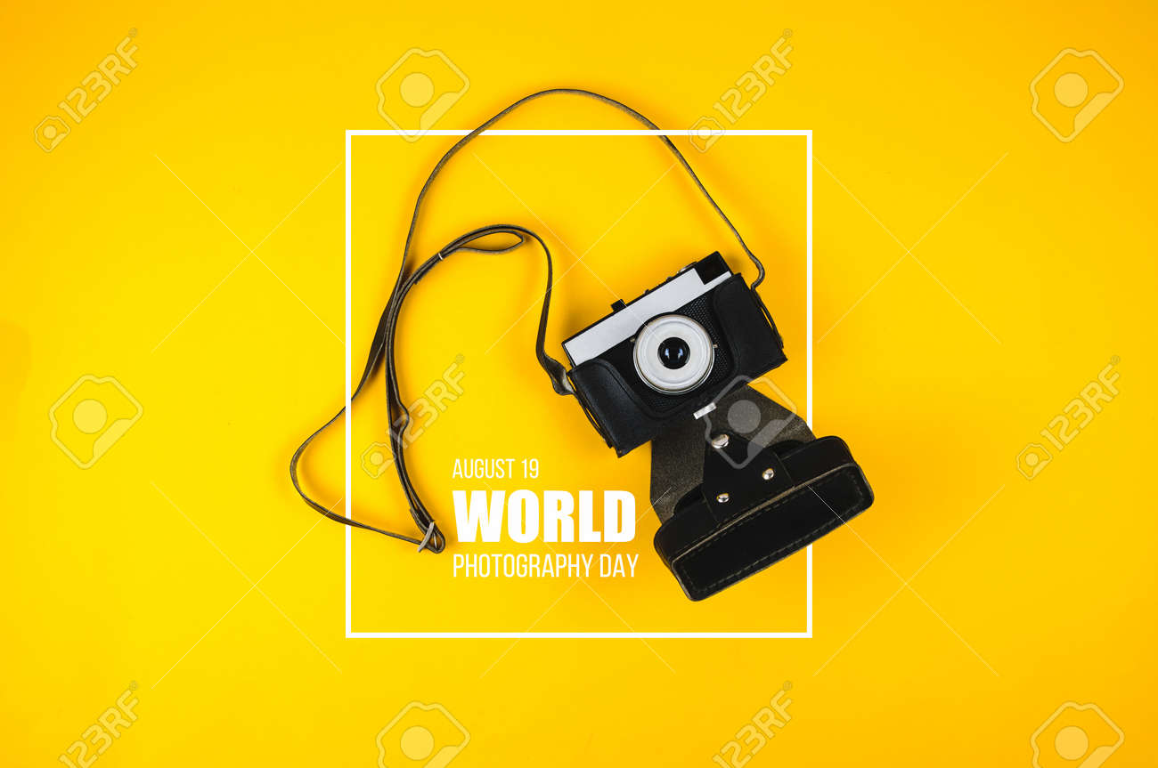Old Camera And Text World Photography Day On Yellow Background Stock Photo Picture And Royalty Free Image Image 131555864