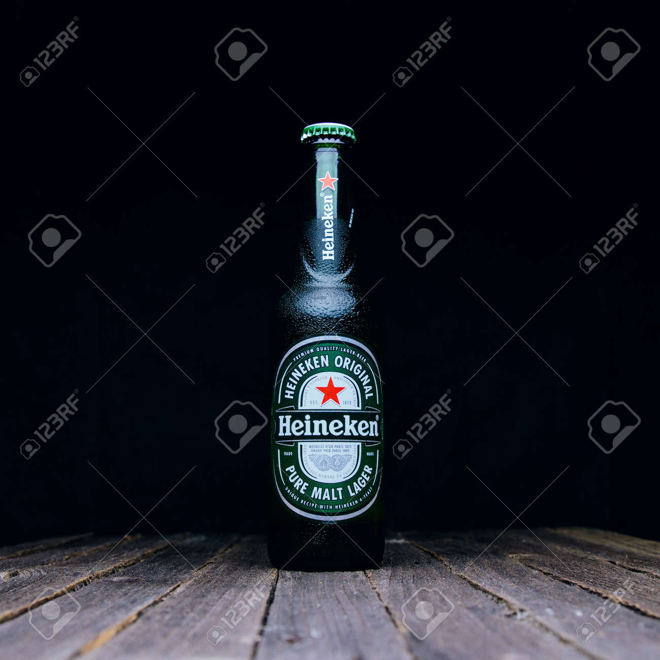 """Russia, Moscow, July 11, 2020: Bottle of """"Heineken"""" beer on a wooden table and dark background - 151378183"""