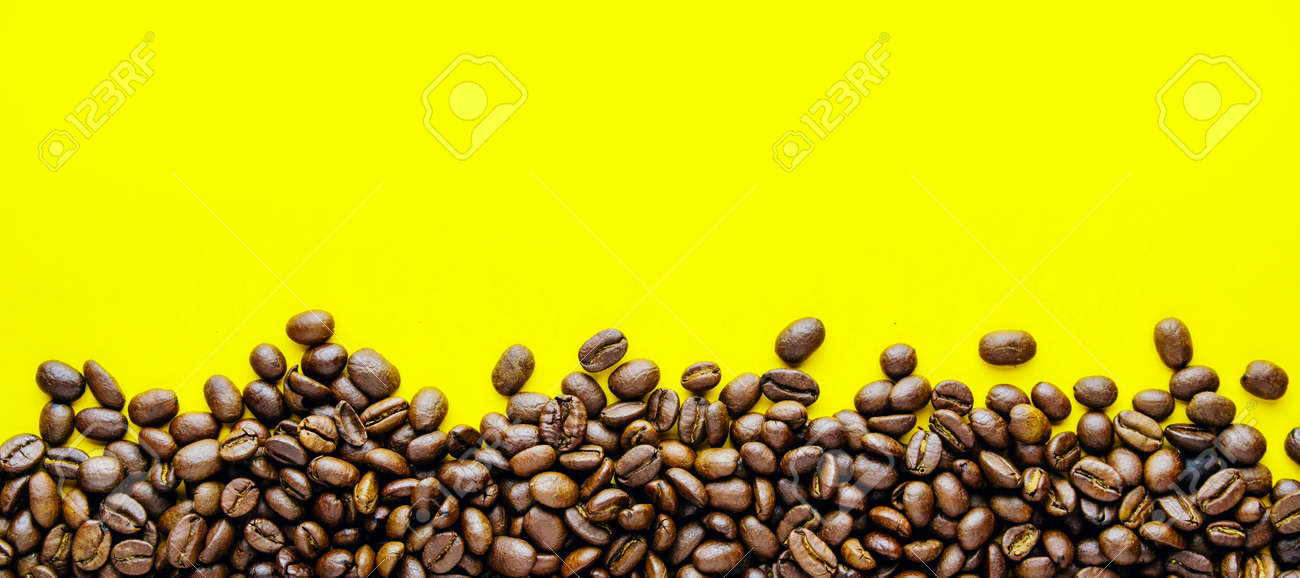 Ð¡offee beans on a bright yellow background. Copy space for text and panoramic frame - 151502001