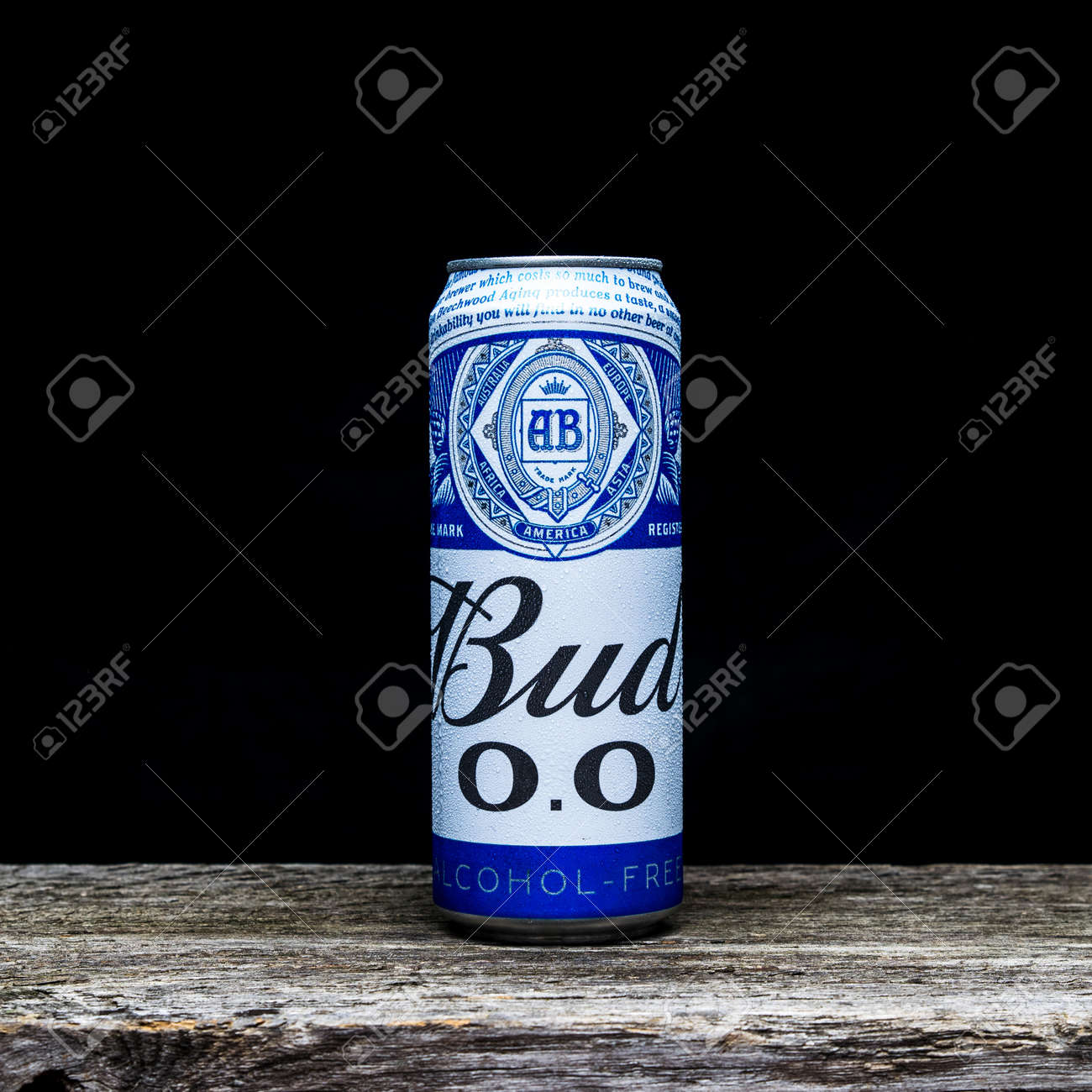 """Russia, Moscow, July 13, 2020: Bottle of nonalcoholic """"Bud"""" beer on a wooden table and dark background - 151526588"""