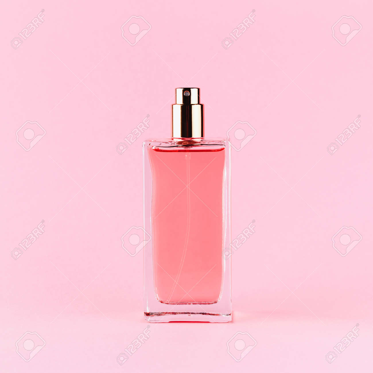 Perfume bottle on a light pink background - 152811669