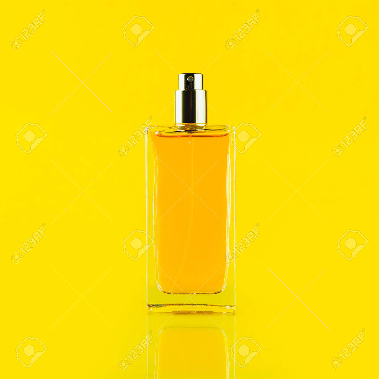 Perfume bottle on a light yellow background - 152811745