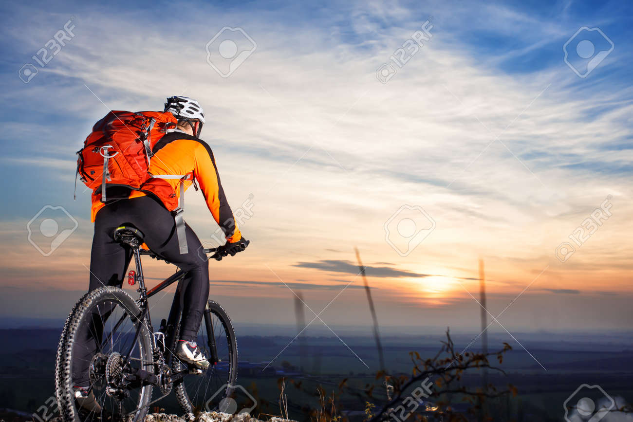 Cyclist on mountain bike at sunset cyclist on the background cyclist on mountain bike at sunset cyclist on the background of beautiful sunset voltagebd Image collections
