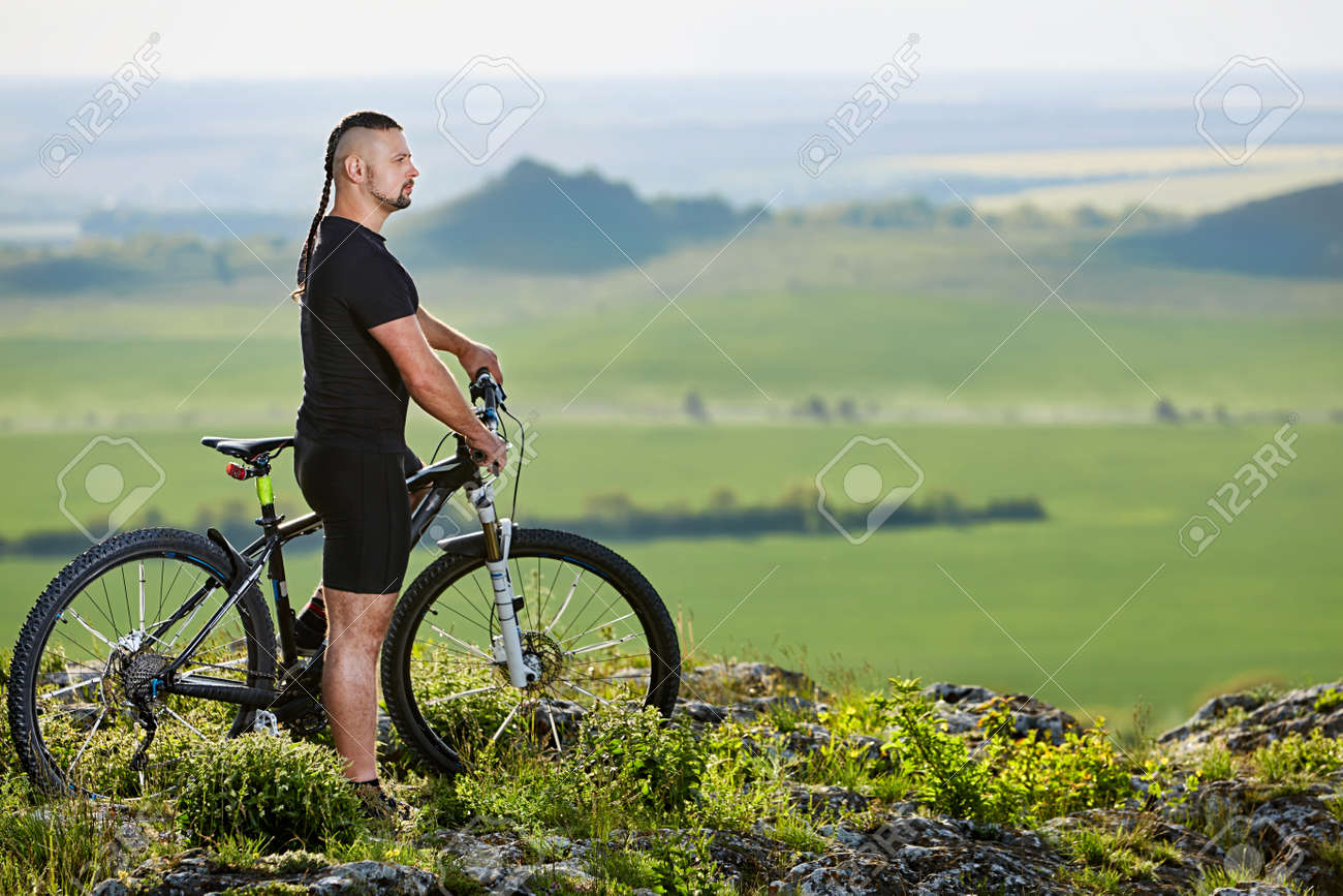 Cyclist standing with mountain bike on background of beautiful cyclist standing with mountain bike on background of beautiful landscape stock photo 79615486 voltagebd Image collections