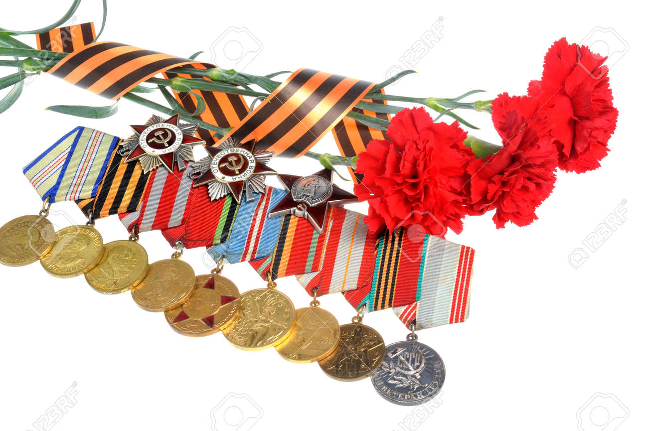 Red carnations turned with Saint George ribbon and medals with
