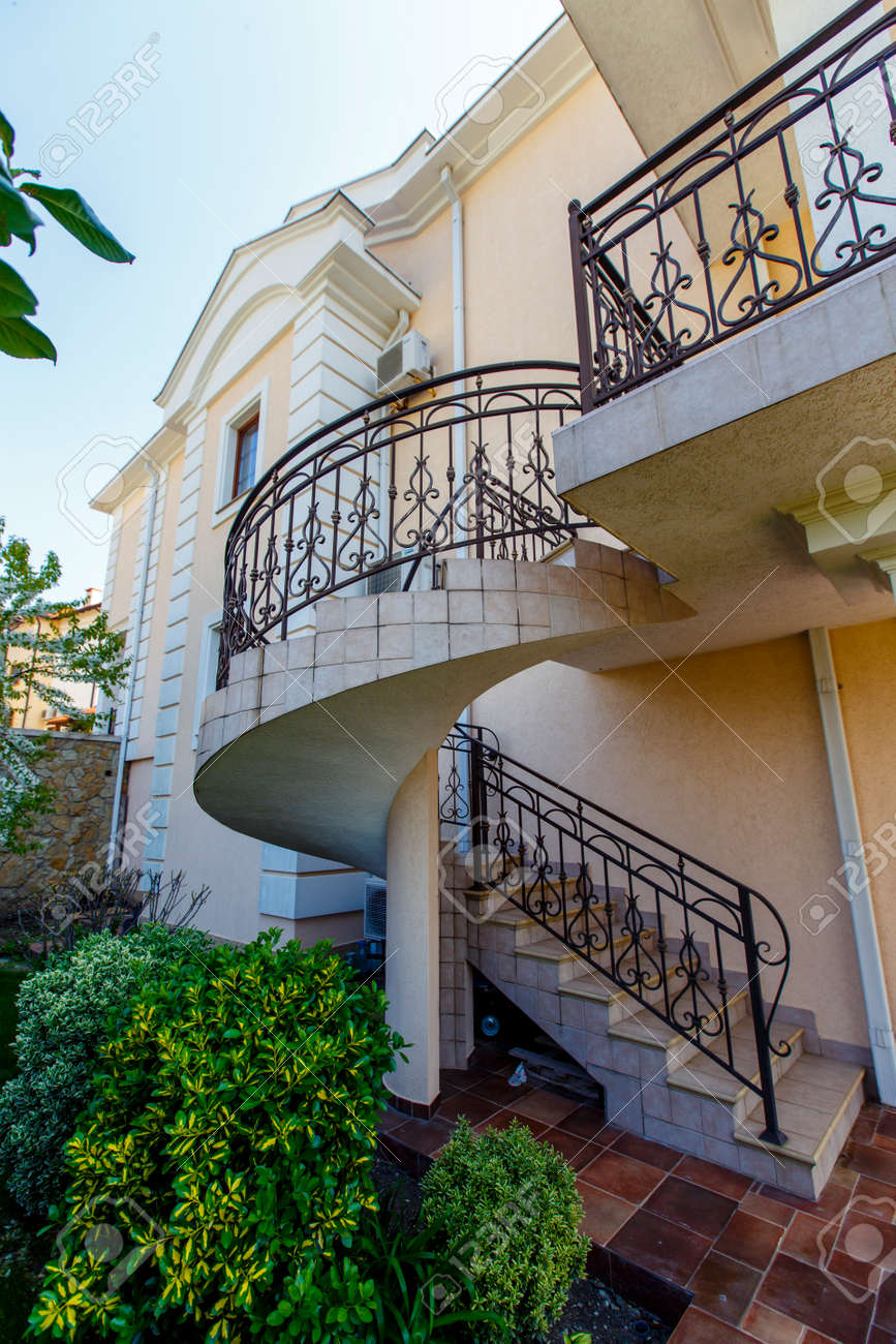 A Concrete Spiral Staircase With Wrought Iron Railings Leads Stock Photo Picture And Royalty Free Image Image 140270205