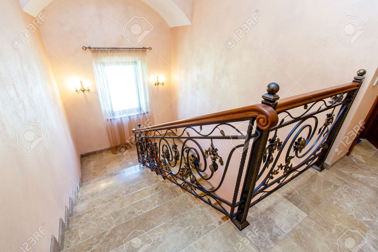Image of: Wrought Iron Staircase In The Cottage Marble Steps Black Wrought Stock Photo Picture And Royalty Free Image Image 140270219