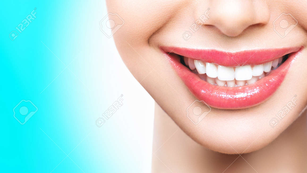 Perfect healthy teeth smile of a young woman. Teeth whitening. Dental clinic patient. Image symbolizes oral care dentistry, stomatology - 134088602