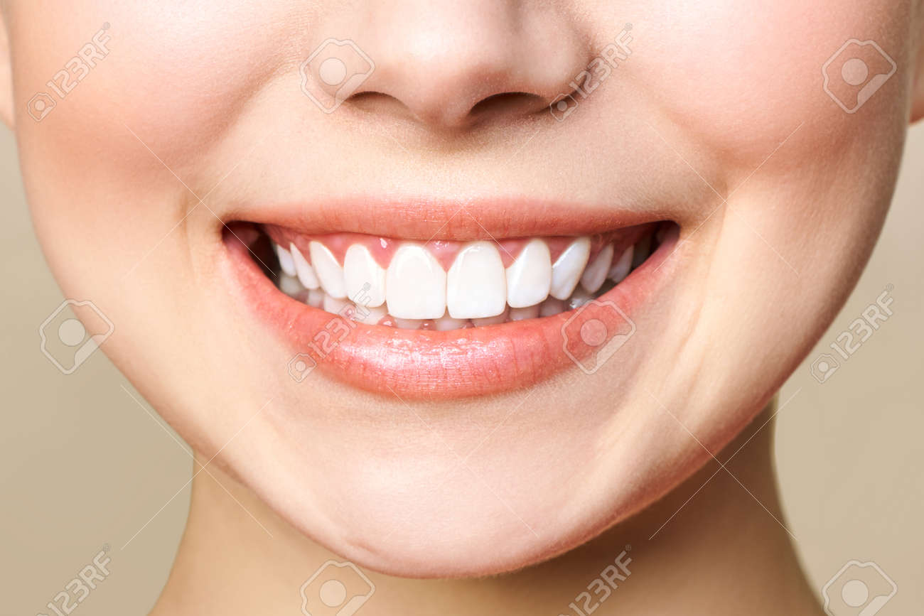 Perfect healthy teeth smile of a young woman. - 135850227