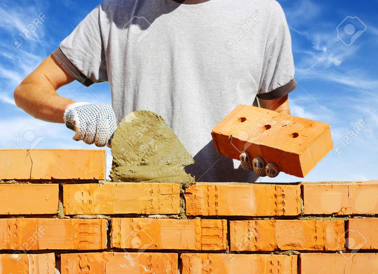 bricklayer laying bricks to make a wall Stock Photo - 12371711