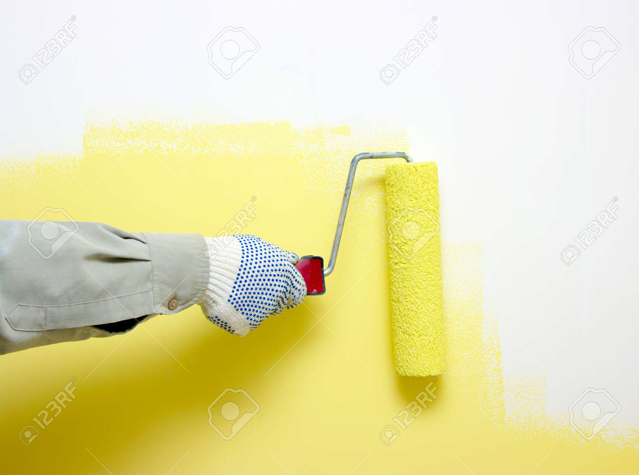 Hand Painting A White Wall With A Paint Roller Stock Photo, Picture ...
