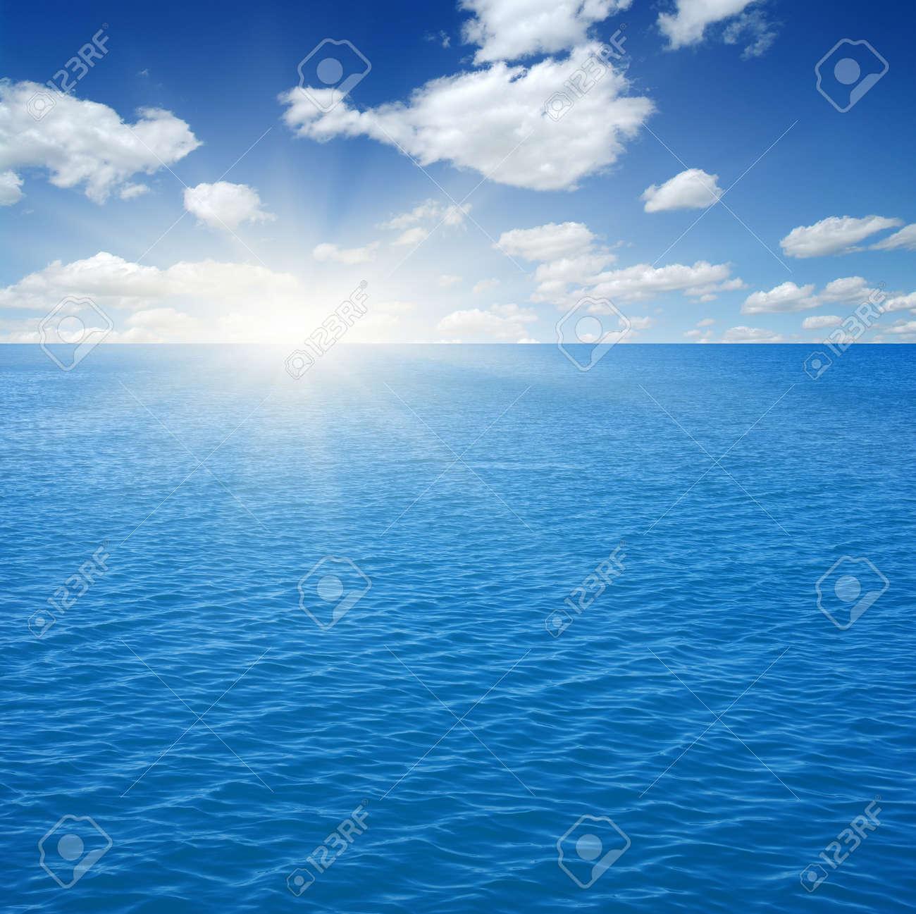Blue sea and sun on sky - 157355404