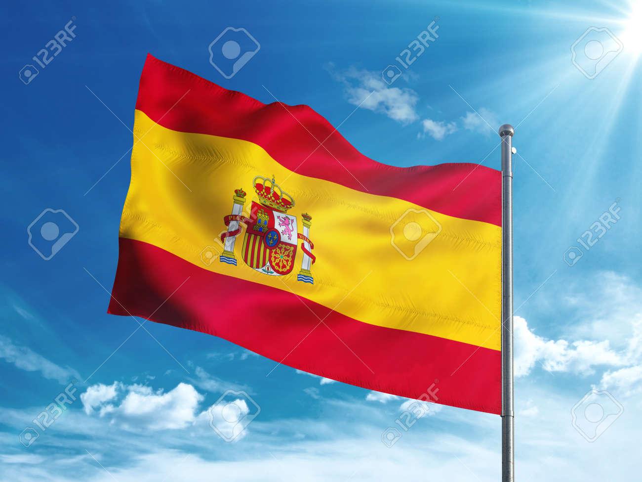 Spain flag waving in the blue sky - 82792164