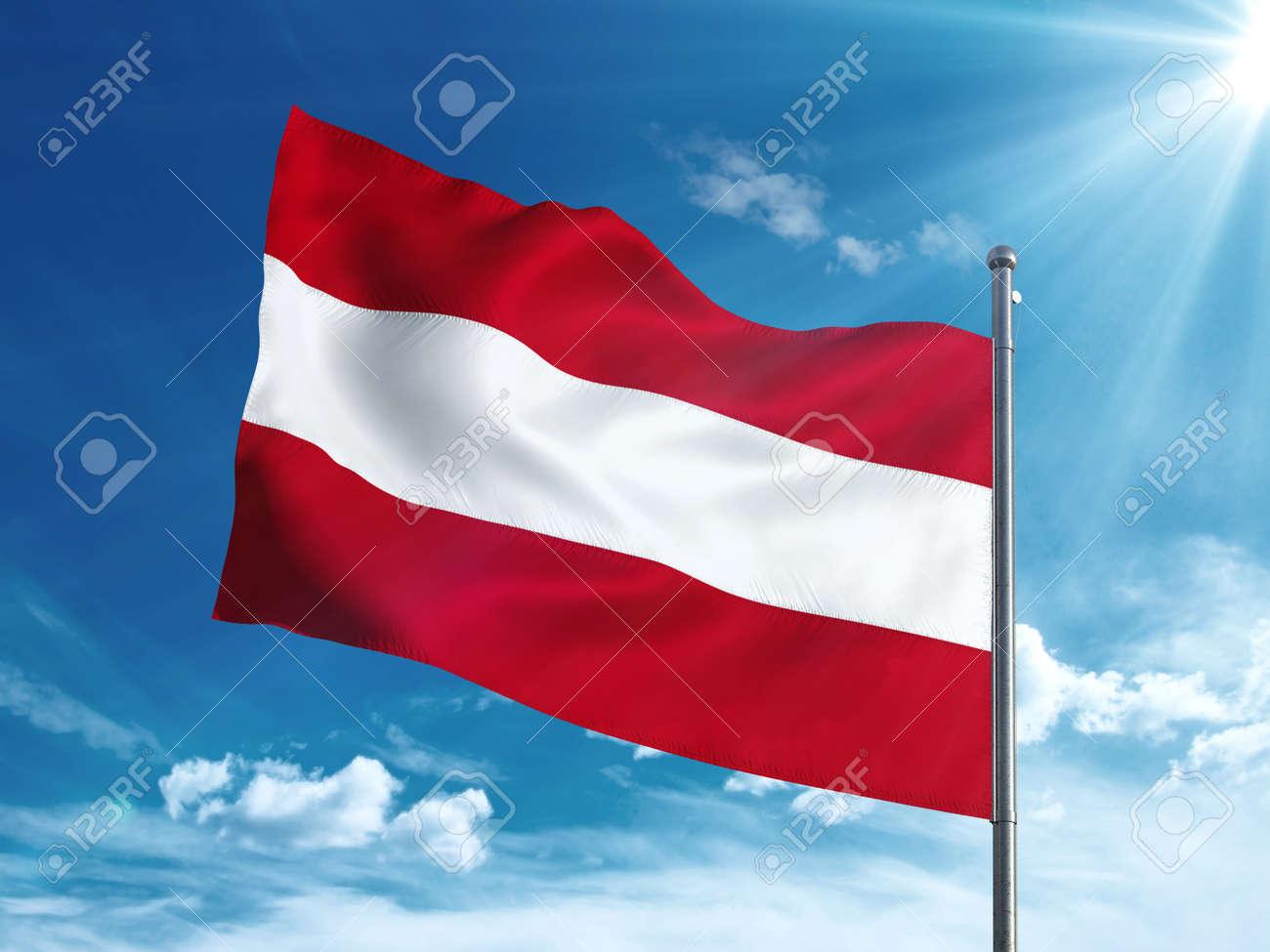 Austria flag waving in the blue sky - 82807969