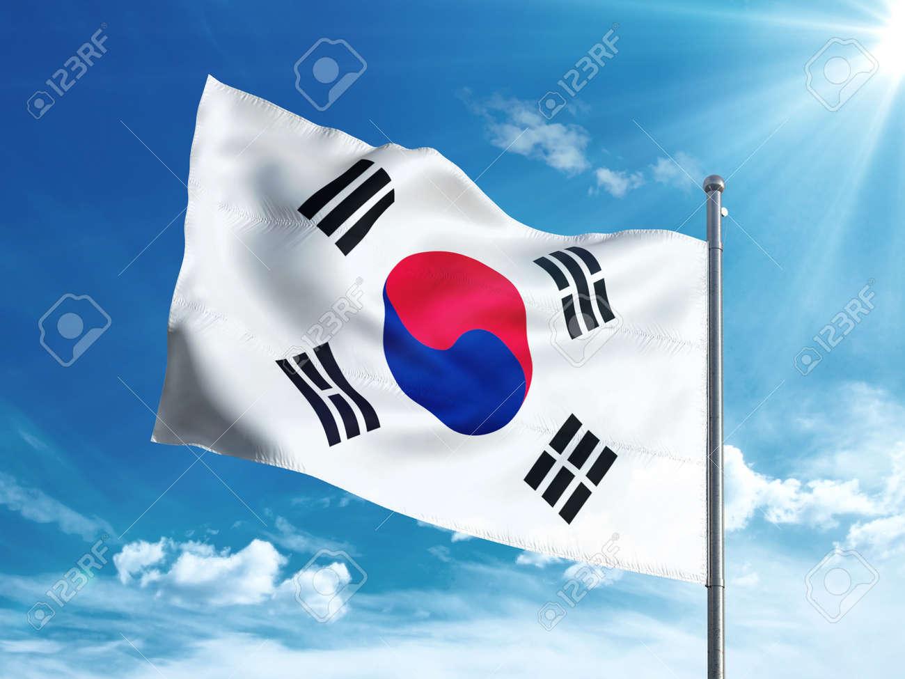 South Korea flag waving in the blue sky - 82792163