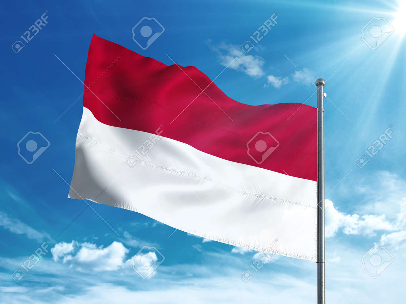 Indonesia flag waving in the blue sky - 82856053