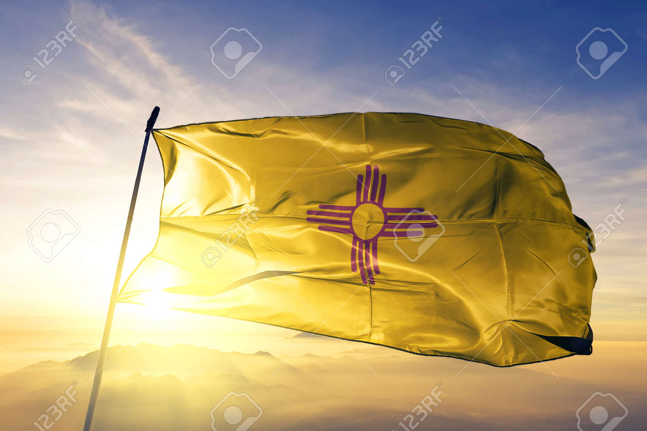 New Mexico state of United States flag textile cloth fabric waving on the top sunrise mist fog - 118785544