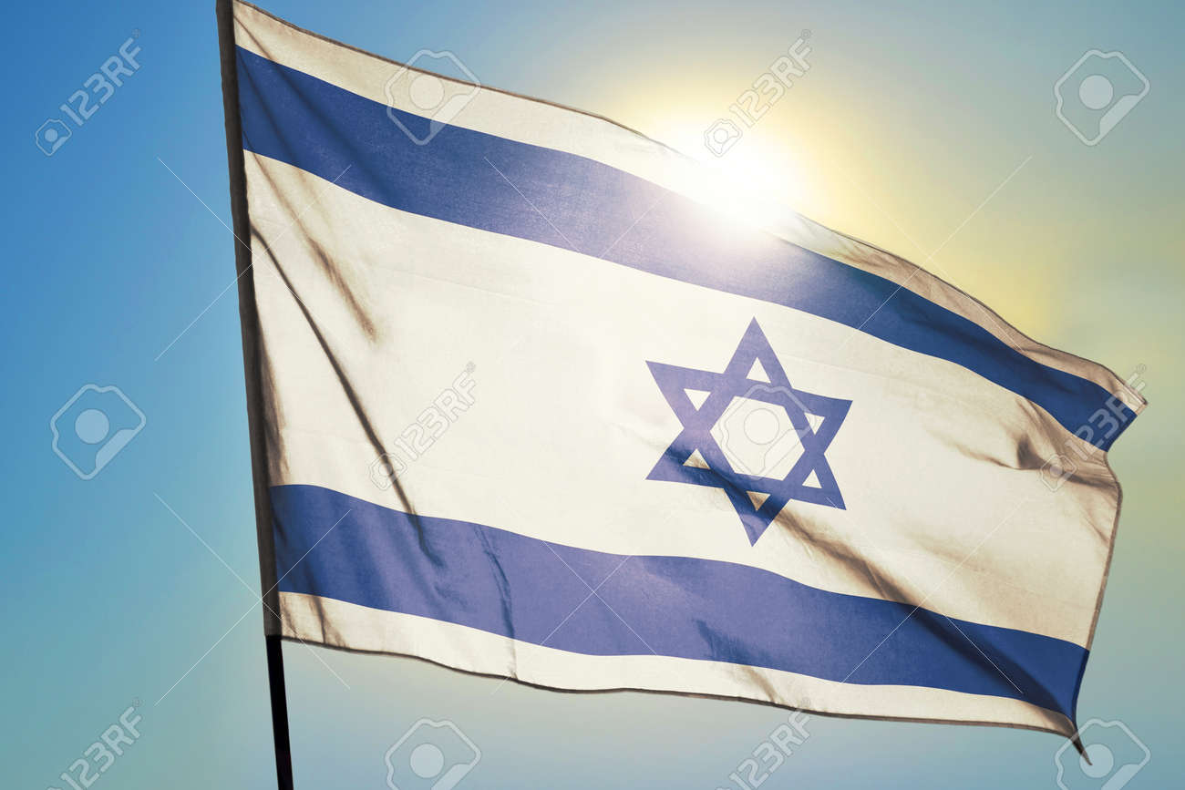 Israel flag waving on the wind in front of sun - 166480080