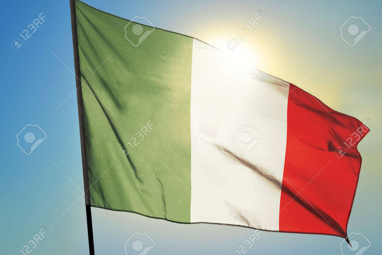 Italy flag waving on the wind in front of sun - 166480081