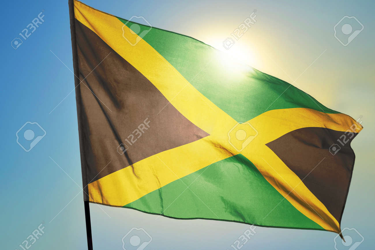 Jamaica flag waving on the wind in front of sun - 166480082