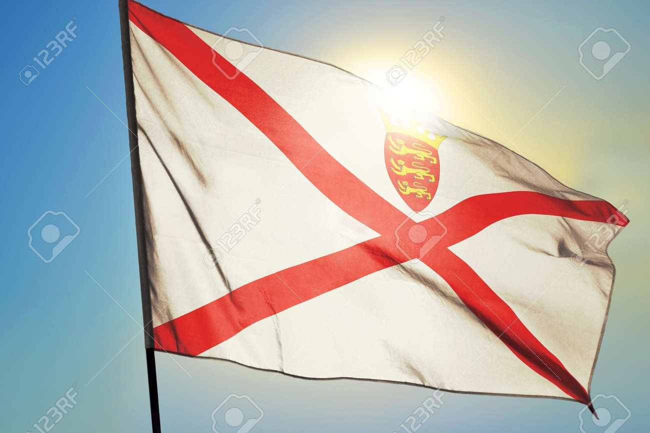 Jersey flag waving on the wind in front of sun - 166480083
