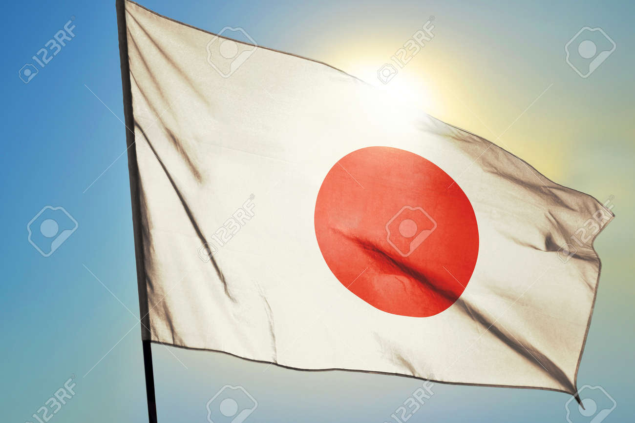 Japan flag waving on the wind in front of sun - 166480084