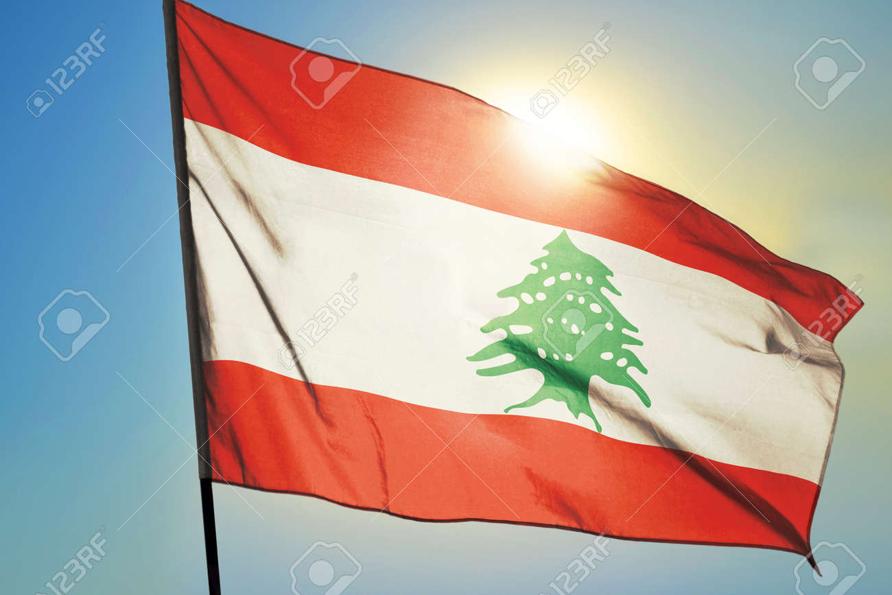 Lebanon flag waving on the wind in front of sun - 166480094