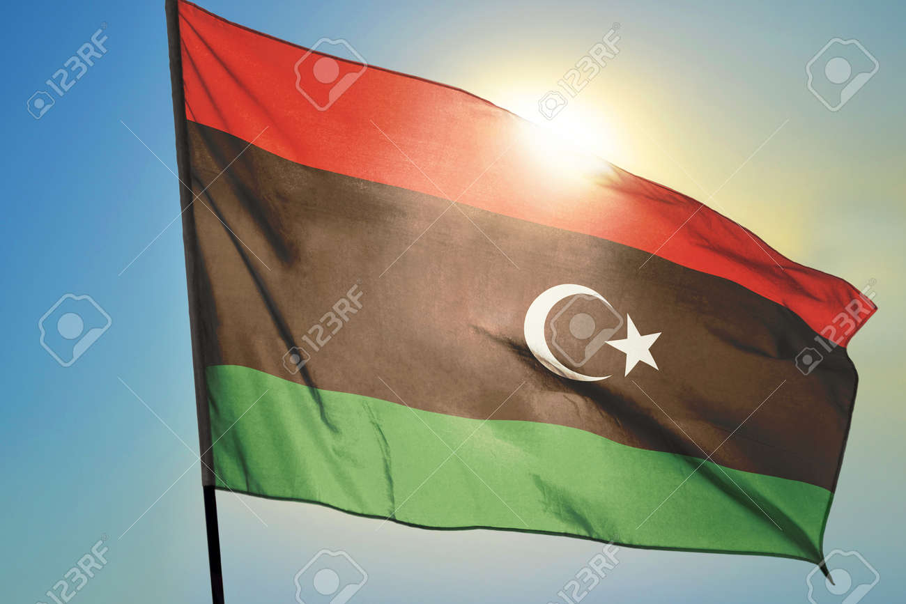 Libya flag waving on the wind in front of sun - 166480097