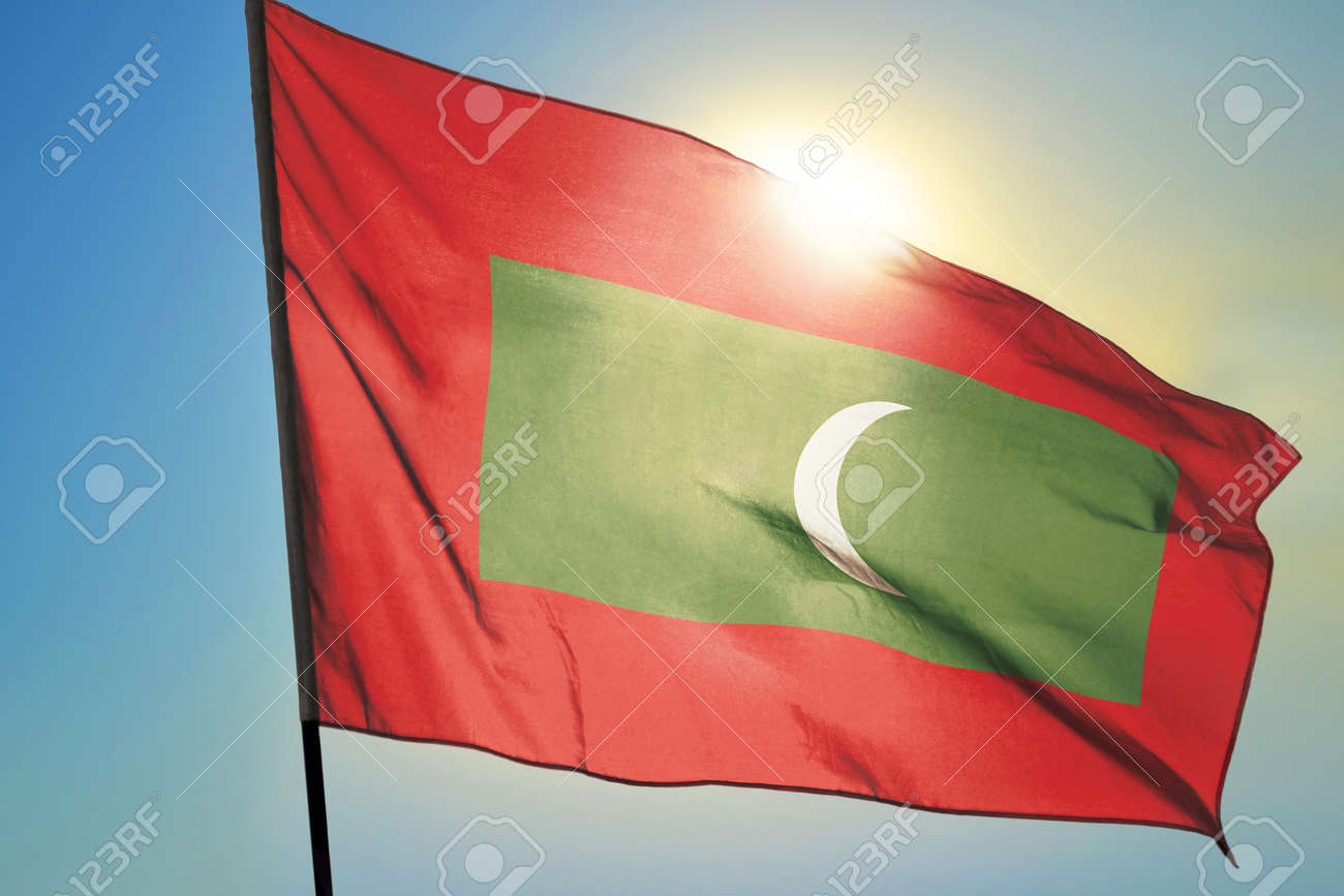 Maldives flag waving on the wind in front of sun - 166480103