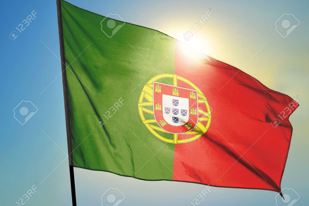 Portugal flag waving on the wind in front of sun - 166480130