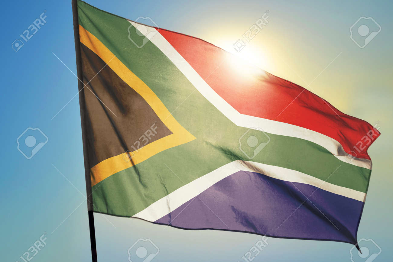 South Africa flag waving on the wind in front of sun - 166480145