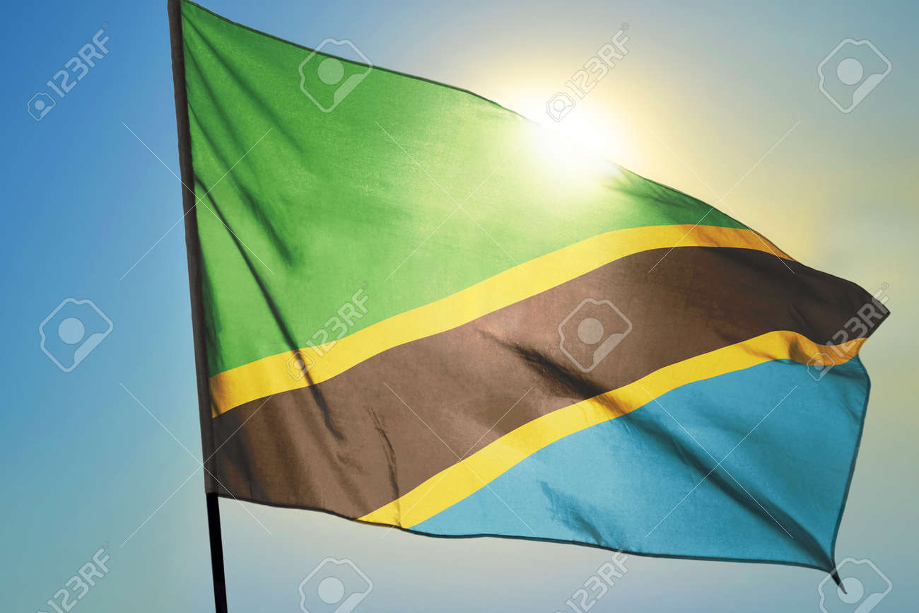 Tanzania flag waving on the wind in front of sun - 166480153