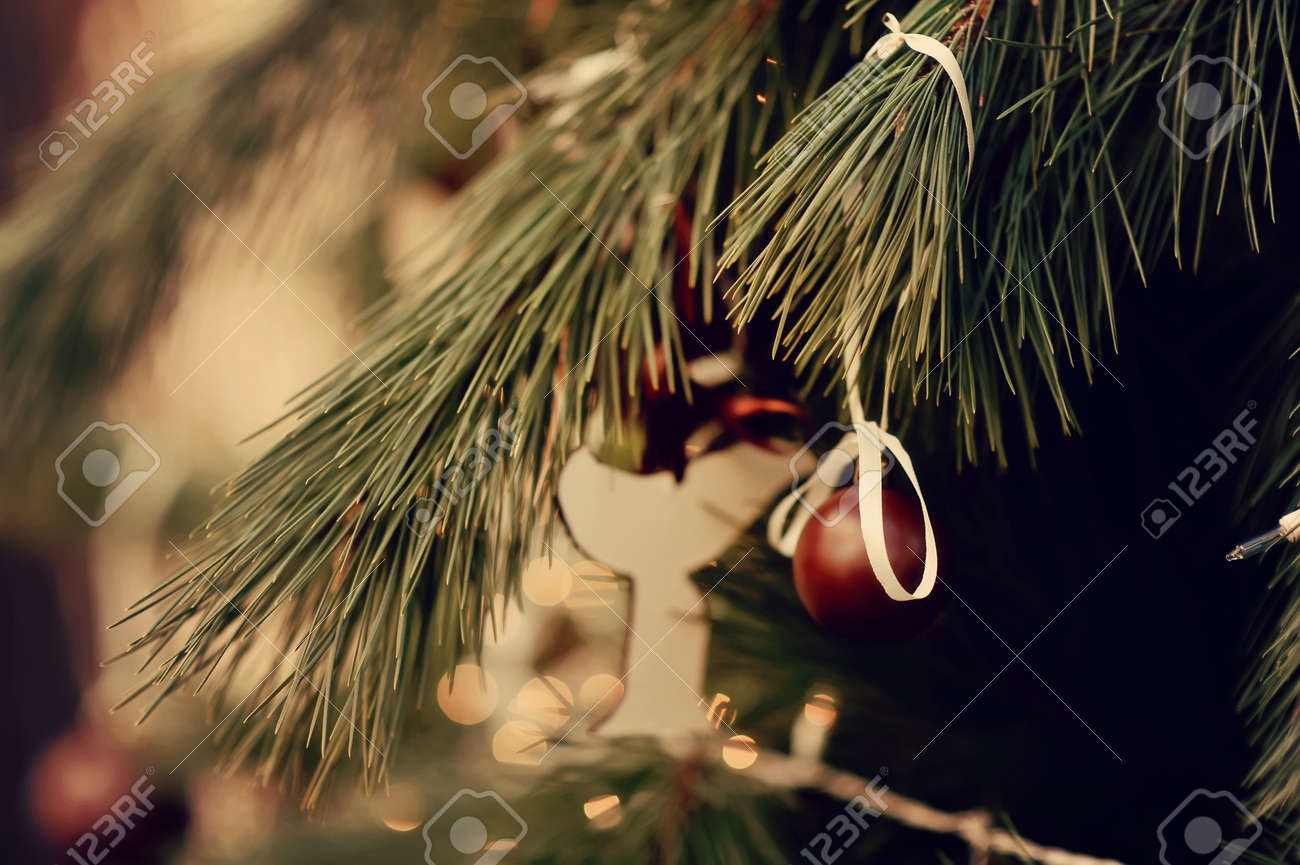 the child decorates a green New Year tree with color toys Stock Photo - 15138823