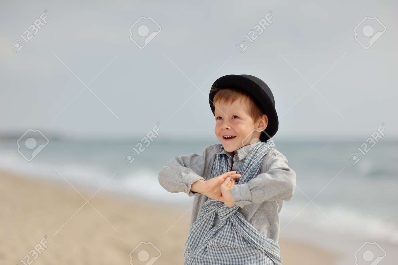 emotional boy in black hat and jeans posing on the beach Stock Photo - 15451883