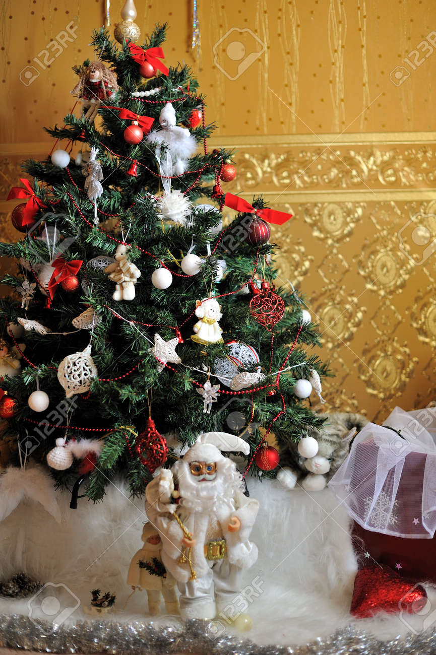 under the Christmas tree is decorated with toys, santa claus in a white suit Stock Photo - 15959557