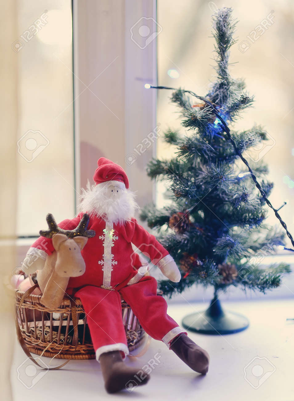 Christmas tree decorated with toys under the Christmas tree and Santa Claus with deer Stock Photo - 15959230