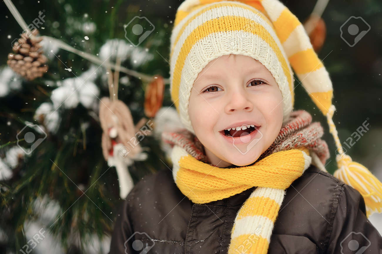 portrait of a boy in a cap on a background of winter trees Stock Photo - 16962497