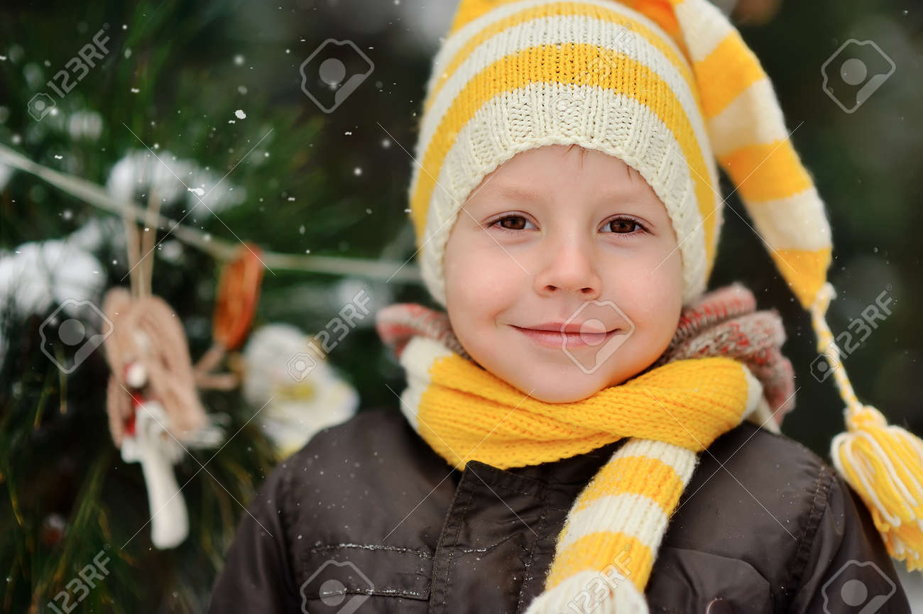 portrait of a boy in a cap on a background of winter trees Stock Photo - 16972269