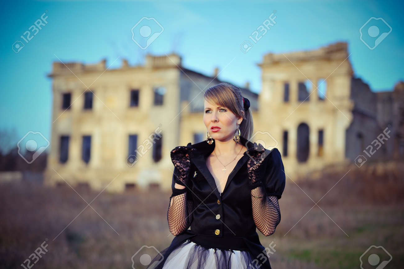 against the background of an old abandoned building blonde girl in a black  dress and gloves ec456d785