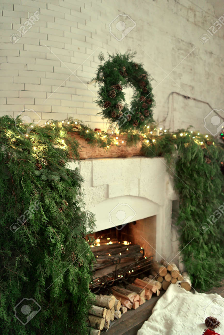 Large Fireplace In The House With Lights And Decorated With Green