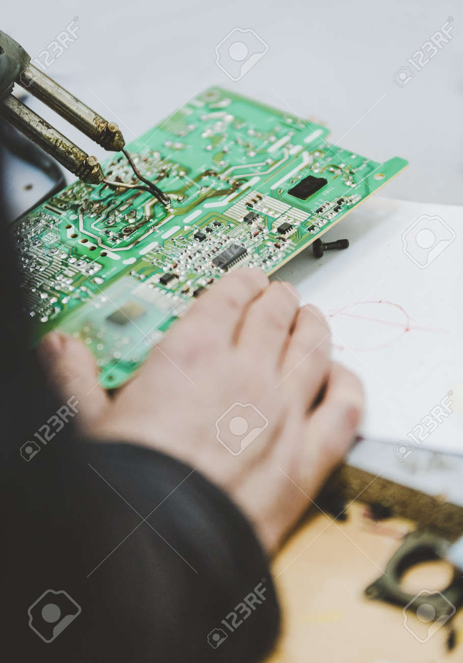 Repairing Electronic Circuitry A Miniature Model Figurine Of Circuit Free Circuits Diagrams Welder At Work On