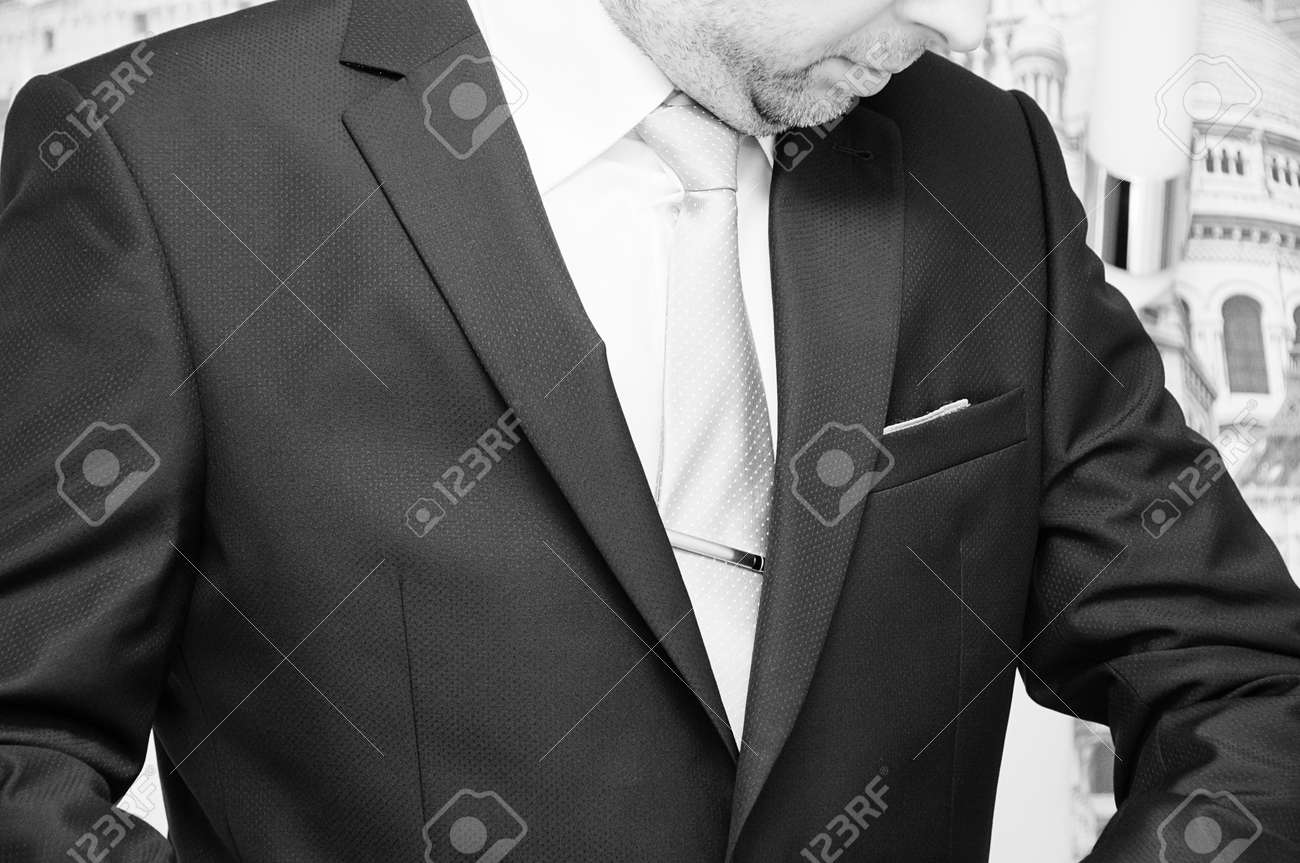 well dressed business man adjusting his neck tie Stock Photo - 17952167