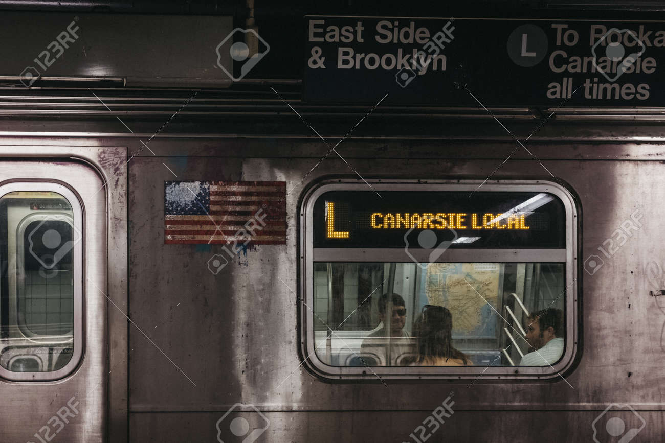 New York, USA - June 2, 2018: Canarsie Local direction announcement on L Line train in New York, USA. New York City Subway is one of the world's oldest public transit systems. - 114644369
