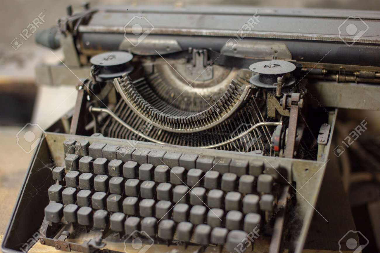 Old, antique typewriter close-up in the dust. - 140875114