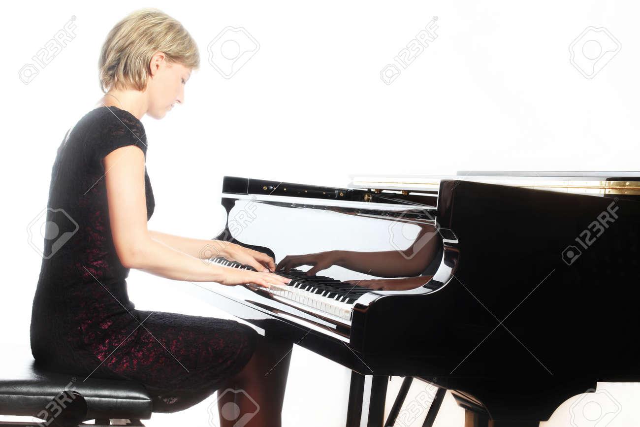 Piano player Standard-Bild - 19968273