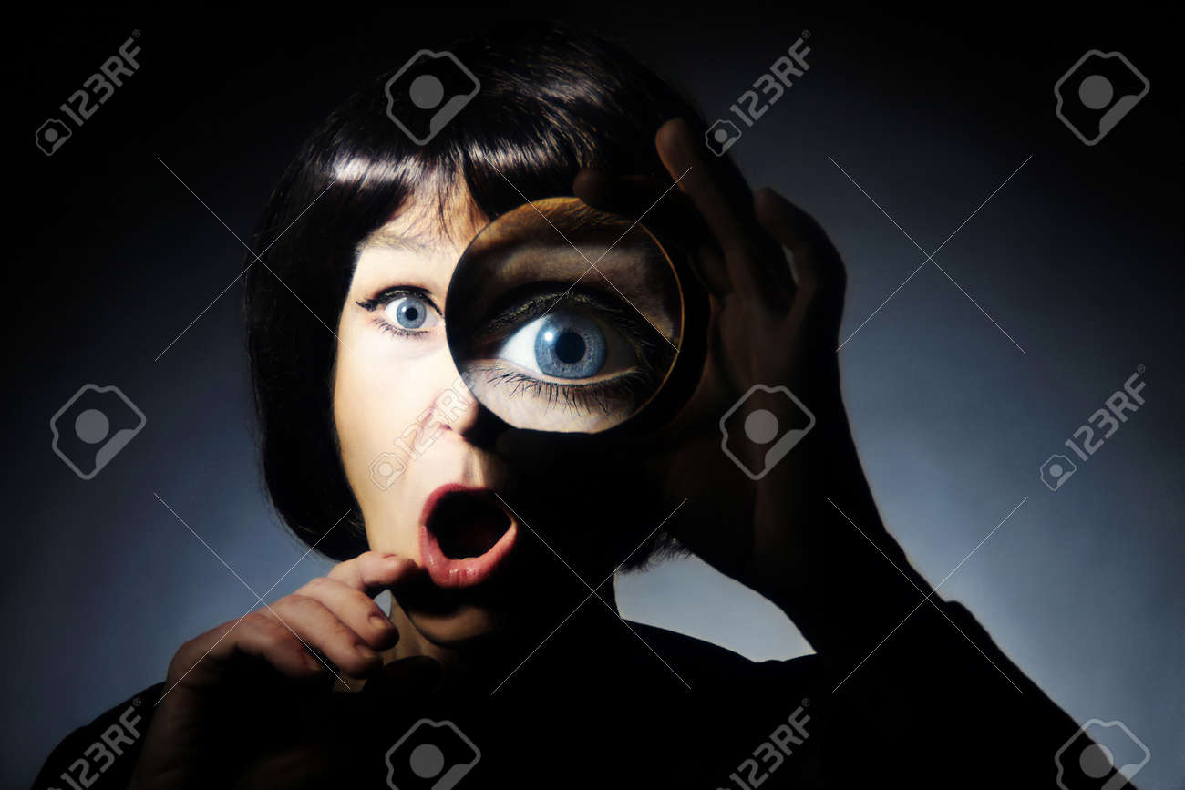 Woman with magnifying glass  Funny surprised lady looking through magnifier loupe with open mouth Standard-Bild - 20836705